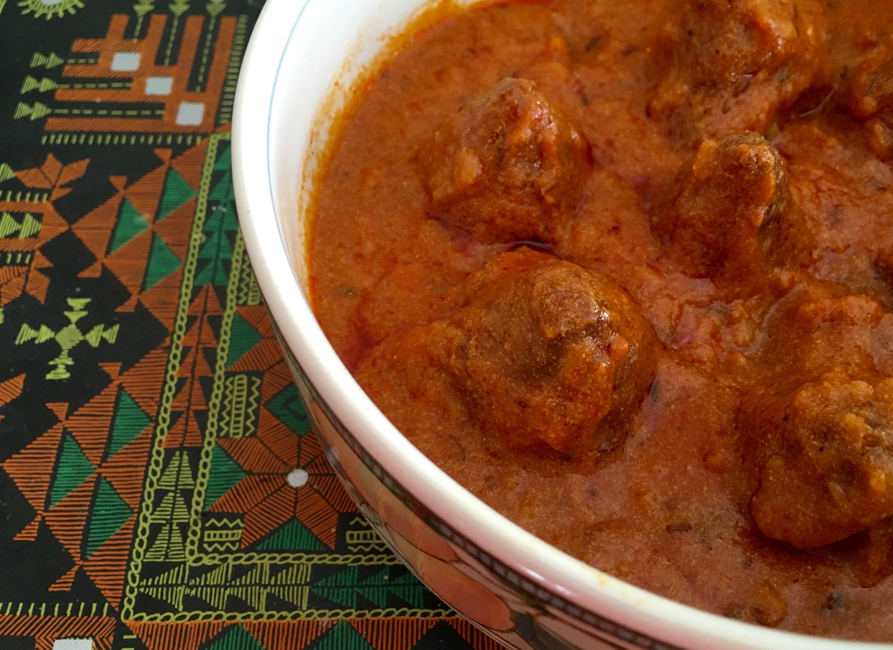 Govind Gatte Stuffed dumplings in tomato gravy